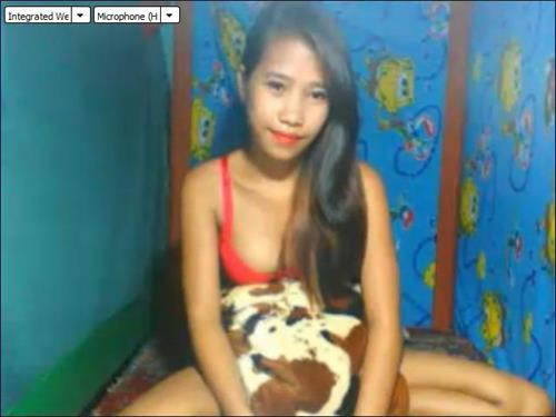 Asian cam model plays with her dog