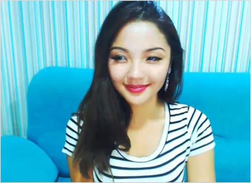 Pretty little asian cam model