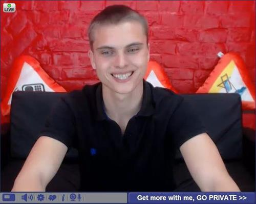 Shaved head smiling male cam model