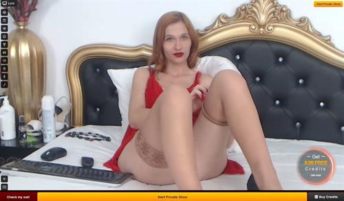 Hot cougar on cam removes stockings, on LiveJasmin.com