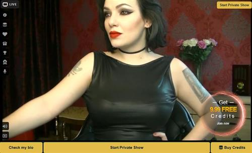 Kinky fetish cam dame with pouting red lips on MyCams.com