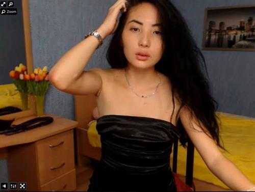Black haired asian plays with her hair