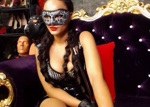 A masked dominatrix with riding crop spotted on ImLive.com